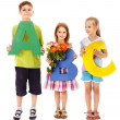 Stock Photo: Children holding abc.