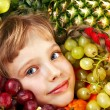 Stock Photo: Child with group fruit and vegetable.