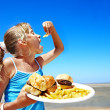 Child eating fast food. — Stock Photo