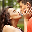 Couple kissing at park. — Stock Photo