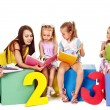 Foto Stock: Children reading book