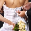 Bridal trying on wedding dress. — Stock Photo