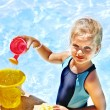 Child with bucket in swimming pool. — Stock Photo #29032395