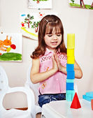 Child with construction set in play room. — Stock Photo