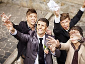 Group men catch bride garter — Stock Photo