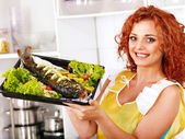 Woman prepare fish in oven. — Stock Photo