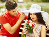 Couple with flower at park. — Stock Photo