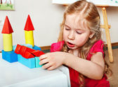 Child preschooler play wood block in play room. — Stock Photo