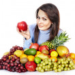 Girl with group of fruit and vegetables. — Stock Photo #30142585