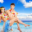Couple with cocktail at Hawaii wreath beach. — Stock Photo #30142669