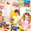 Stock Photo: Children painting at school.