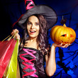 Stock Photo: Woman holding Halloween shopping bag.