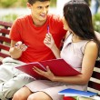 Couple student with book outdoor. — Stock Photo