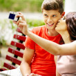 Couple   with camera take pictures — Foto Stock