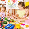 Child painting at easel. — Stock Photo #30142843