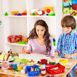 Child paintitng with mom. — Stock Photo