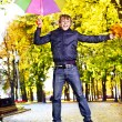 Man holding  autumn umbrella. — Stock Photo