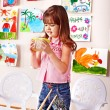 Stock Photo: Child girl with clay in play room.