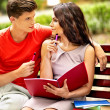 Couple student with notebook outdoor. — Stock Photo