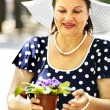 Happy old woman with flower outdoor. — Stock Photo #30143297