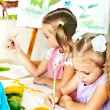 Child painting at easel. — Stock Photo #30143351