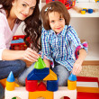 Family with child playing bricks. — Stock Photo #30143489