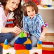 Family with child playing bricks. — Stockfoto #30143489