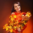 Woman holding autumn basket. — Stock Photo #30143533