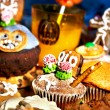 Halloween table with trick or treat — Stock Photo #30143631