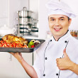 Man in chef hat cooking chicken — Stock Photo #30143671