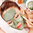 Clay facial mask in beauty spa. — Stock Photo #30143781