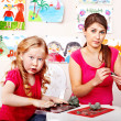 Teacher and kid playing with clay. — Stock Photo