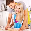 Young family cooking at kitchen. — Stock Photo #30143907