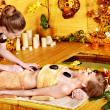 Stock Photo: Womgetting stone therapy massage .
