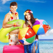 Couple with beach accessories at Hawaii . — Stock Photo