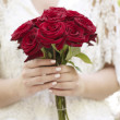 Bride with rose bouquet — Stock Photo #30143977