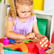 Stock Photo: Child girl glue in preschool.