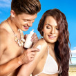 Couple applying sunblock at beach. — Stock Photo #30144041