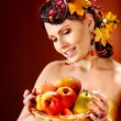 Stock Photo: Woman holding autumn basket.