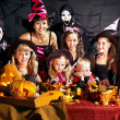 Stock Photo: Children on Halloween party making pumpkin