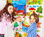Family with child painting . — Stock Photo