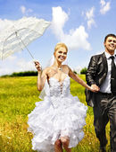 Bride and groom summer outdoor. — Stock Photo