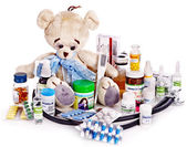 Child medicine and teddy bear. — Stock Photo