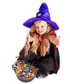 Şeker ile küçük kız cadı. — Stok fotoğraf