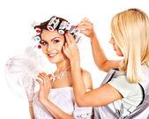 Woman wear hair curlers on head. — Stock Photo