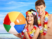 Couple with beach ball at Hawaii beach. — Stock Photo