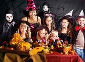 Children on Halloween party making pumpkin — Stock Photo
