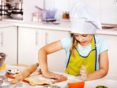 Child knead dough at kitchen. — Stock Photo