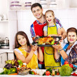 Happy family with grandmother at kitchen. — Stock Photo