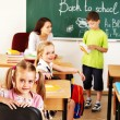 Children in classroom near blackboard. — Stock Photo #30432769
